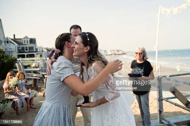 """bride giving gift to her daughters during small wedding. - """"martine doucet"""" or martinedoucet stock pictures, royalty-free photos & images"""