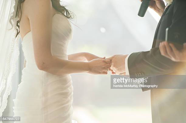 bride & groom during ceremony - wedding vows stock pictures, royalty-free photos & images