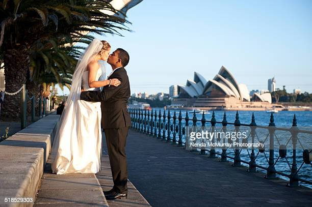 Bride & Groom kissing with Opera House