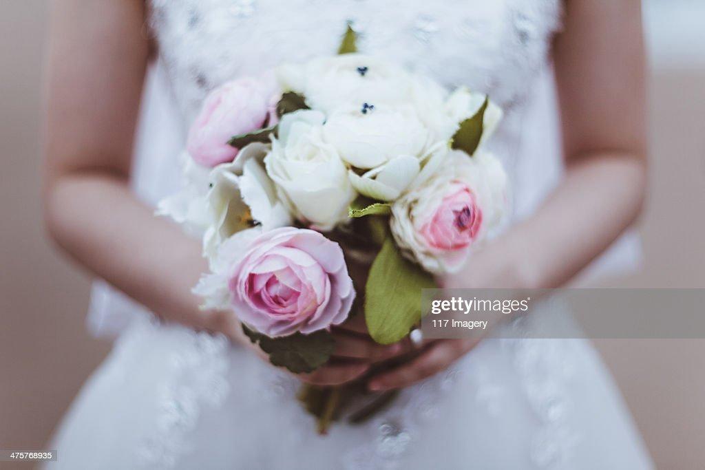 Bride hands holding bouquet : Stock Photo
