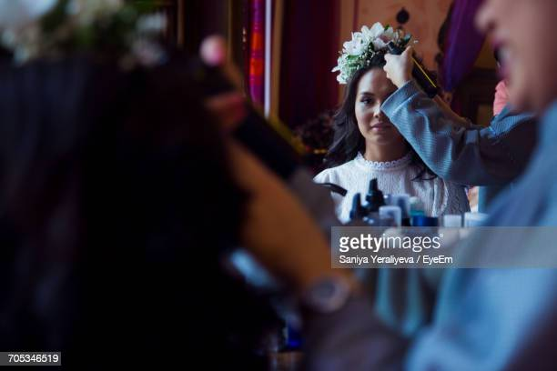 Bride Having Her Hair Styled By Hairstylist