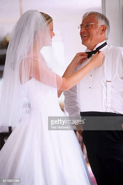 Bride Helping Father with Bow Tie