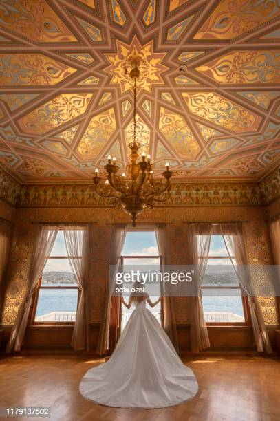 bride history palace leaving - wedding in the seascape luxury hotel - gold dress stock pictures, royalty-free photos & images
