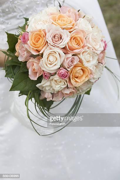 Bride holding a rose bouquet