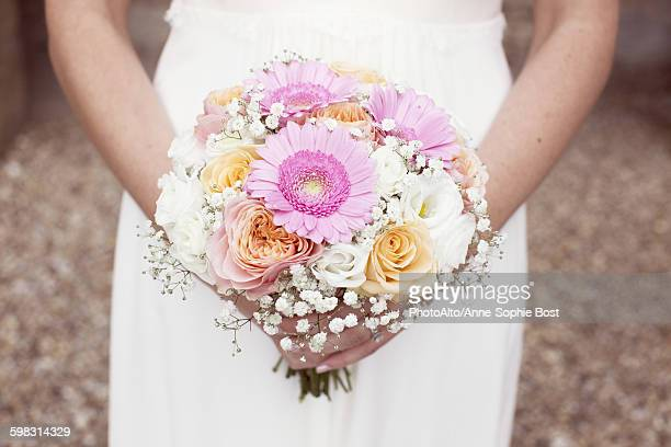 bride holding bouquet of flowers, cropped - sophie rose bildbanksfoton och bilder
