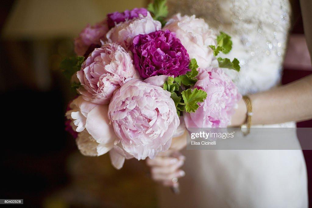 Bride holding bouquet of peony flowers : Stock Photo