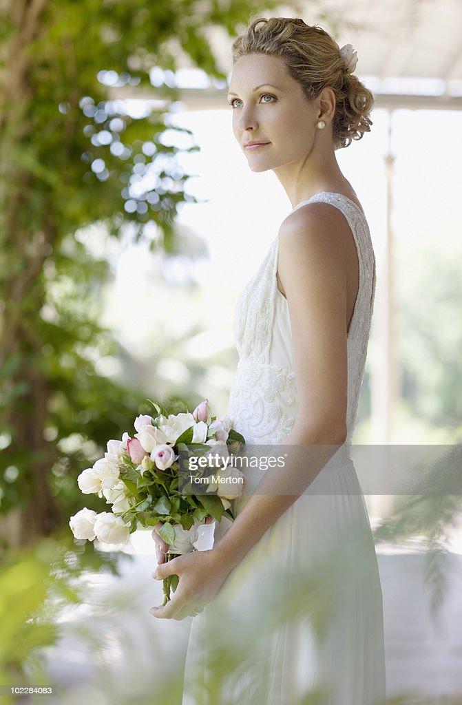 Bride holding bouquet : Stock Photo