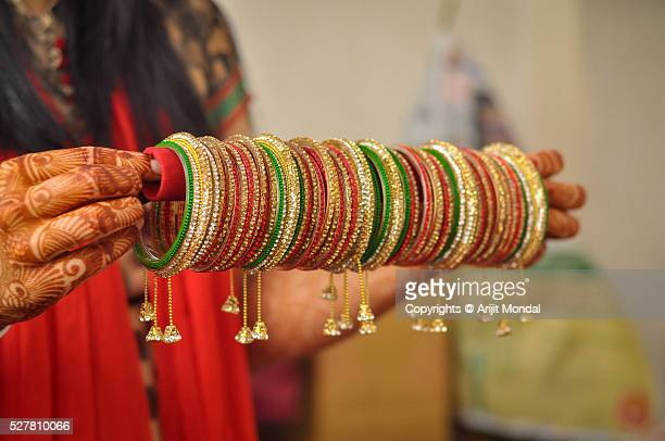 bride holding bridal bangles - bangle stock pictures, royalty-free photos & images