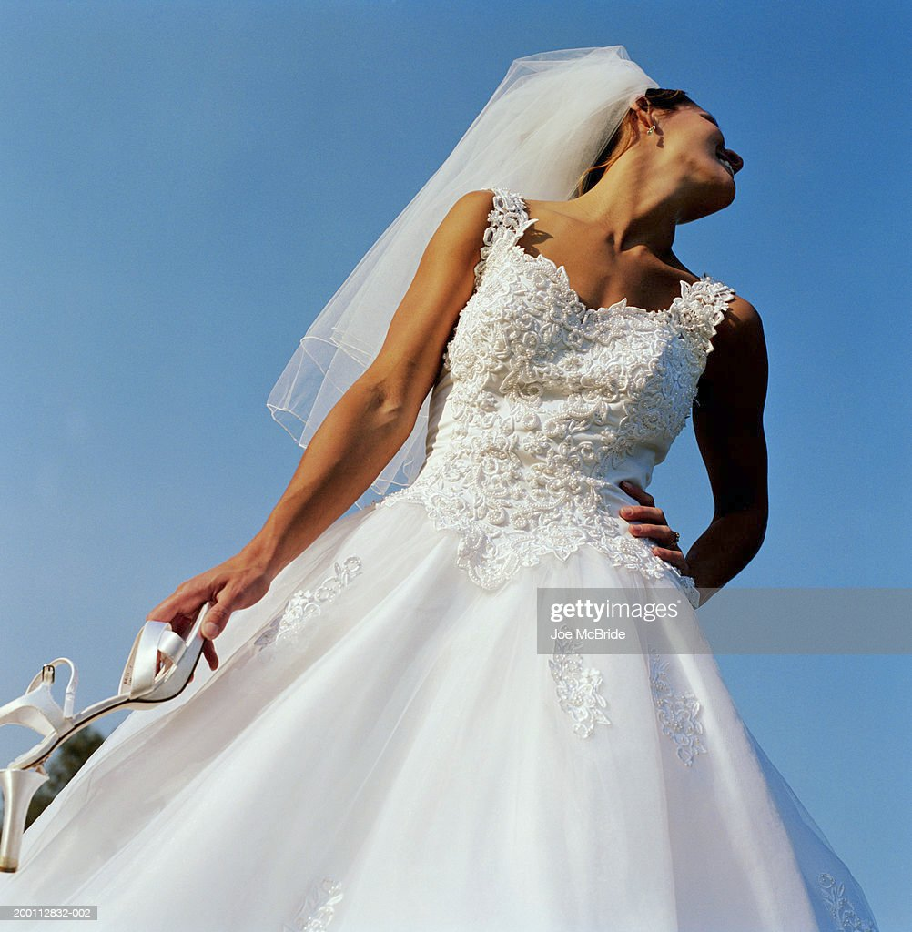 Bride Holding Broken High Heel Smiling Low Angle View Stock Photo ...