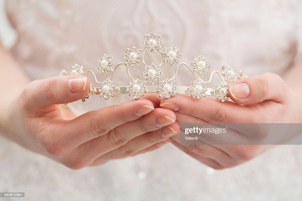 Bride holding diadem : Stock Photo