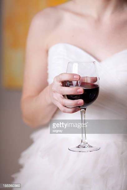 bride holding glass of wine - strapless dress stock pictures, royalty-free photos & images