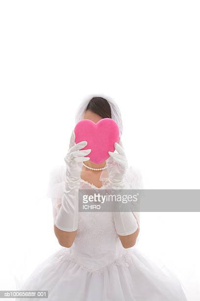 bride holding heart in front of face, white background - evening glove stock pictures, royalty-free photos & images