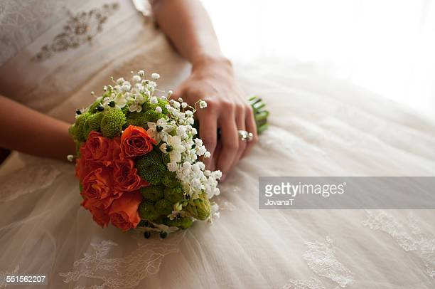 Bride holding her flowers bouquet