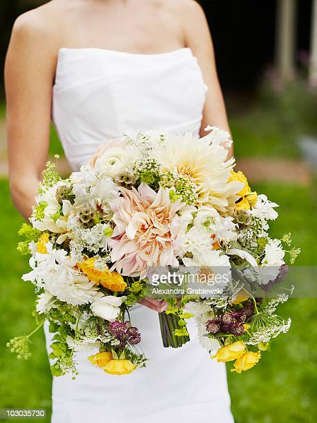 Bride Holding Large Spring Bouquet