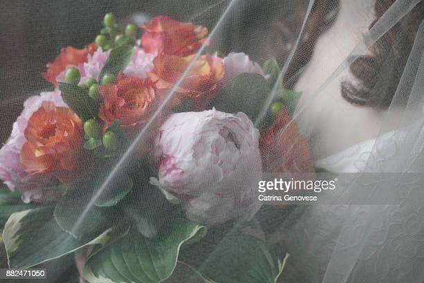 Bride holding mixed flower wedding bouquet.