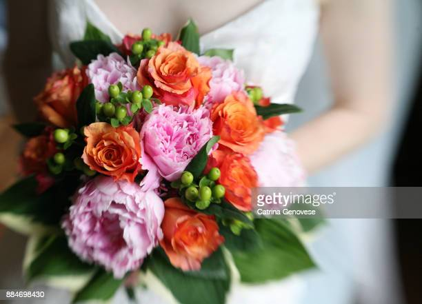 bride holding mixed flower wedding bouquet