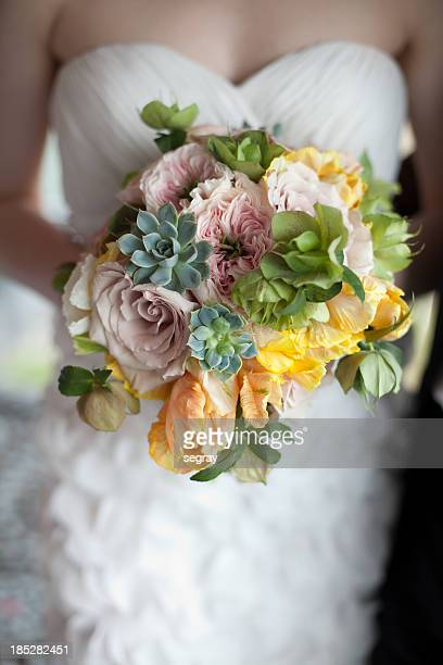 bride holding springtime bouquet - succulent stock photos and pictures
