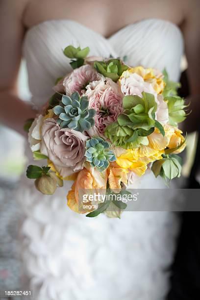 bride holding springtime bouquet - bouquet stock pictures, royalty-free photos & images