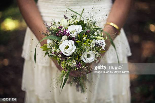 bride holding wedding bouque - mid section stock pictures, royalty-free photos & images