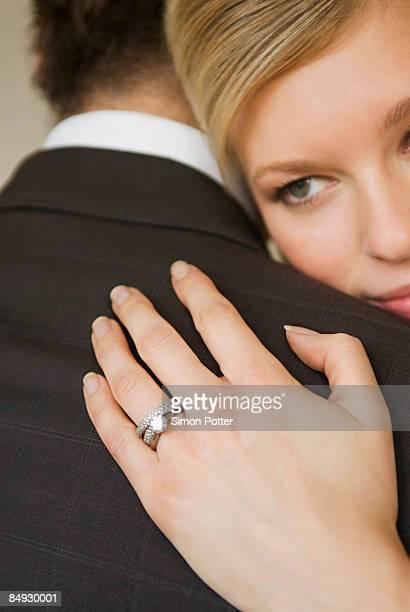 A bride hugs her husband