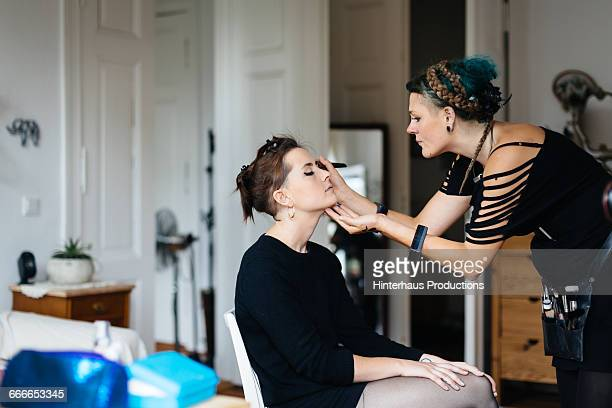 Bride in her apartment getting Make-up applied