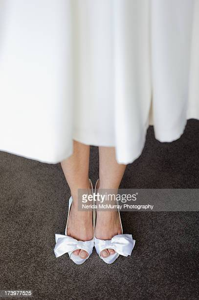 Bride in her shoes close up