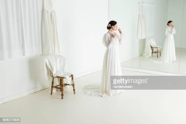 bride in the dress shop - full length mirror stock photos and pictures