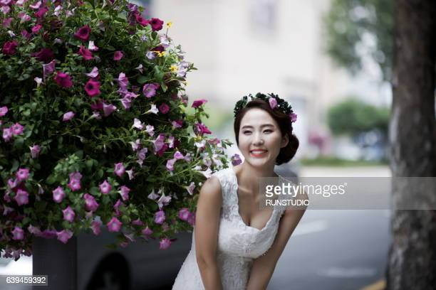 bride in the park with flowers