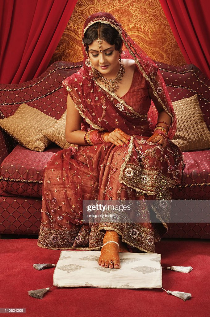 Bride In Traditional Wedding Dress Looking At Henna Decoration On ...