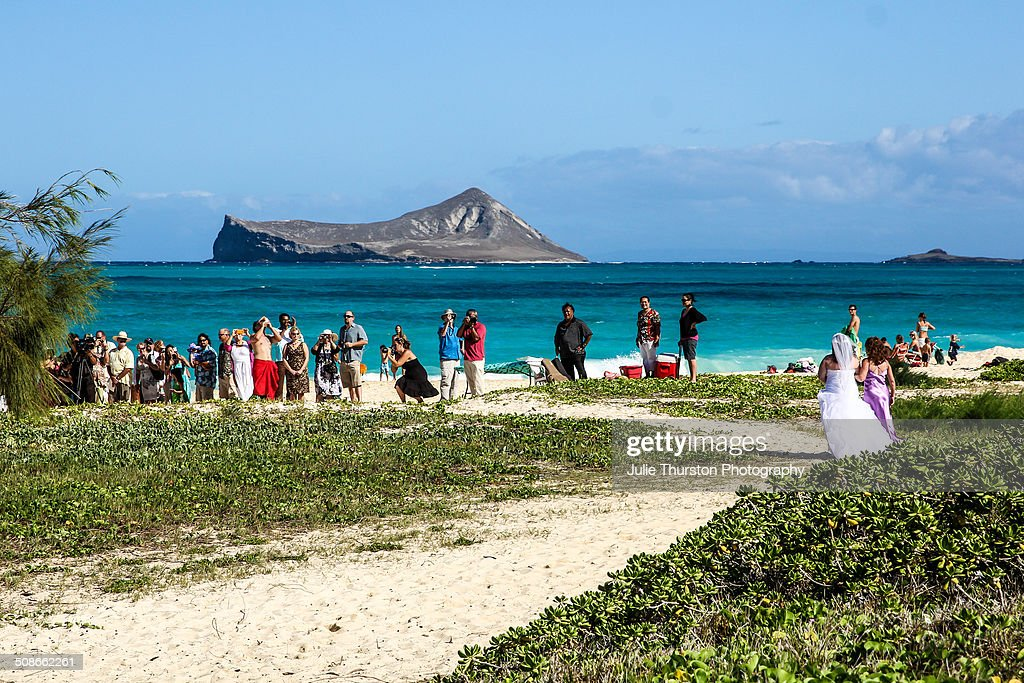 Bride in White Gown Heading to the Alter During a Summertime Destination Wedding at Waimanalo Beach With Rabbit Island and the Teal Colored Pacific Ocean in the Distance in Tropical Hawaii on the Island of Oahu