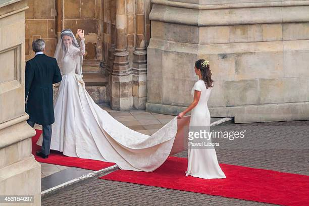 Bride Kate Middleton with her father Michael Middleton and bridesmaid sister Philippa walking into Westminster Abbey for the Royal Wedding to HRH...