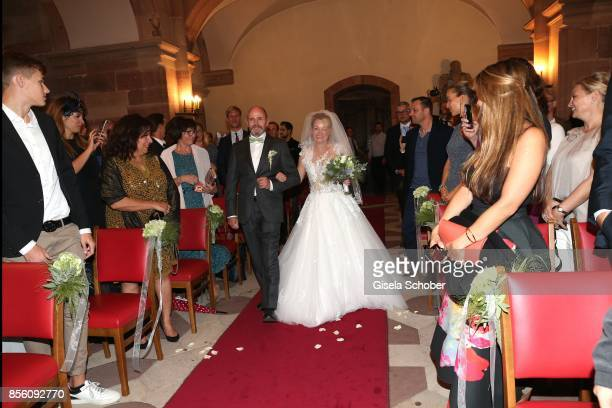 Bride Katja Ohneck and her father Georg Ohneck during the church wedding of Erdogan Atalay and Katja Ohneck at Heidelberg Castle on September 30 2017...