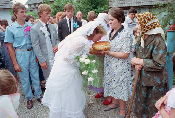 Russian Bride Kissing Bread Loaf Pictures | Getty Images