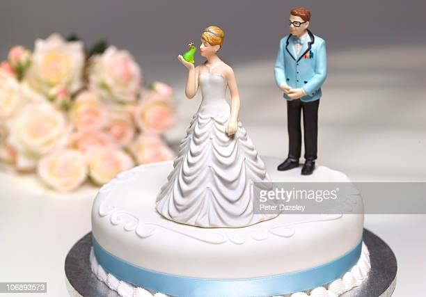 bride kissing frog with geek husband behind - figurine stock pictures, royalty-free photos & images