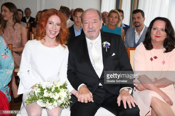 Bride Laura Kaefer and bridegroom Ralph Siegel and maid of honor Bettina Weyers during their civil wedding at the registry office Gruenwald on...