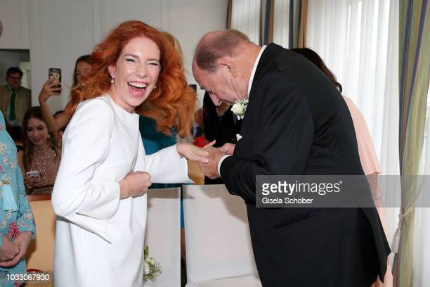 Bride Laura Kaefer and bridegroom Ralph Siegel exchanges rings during their civil wedding at the registry office Gruenwald on September 14 2018 in...