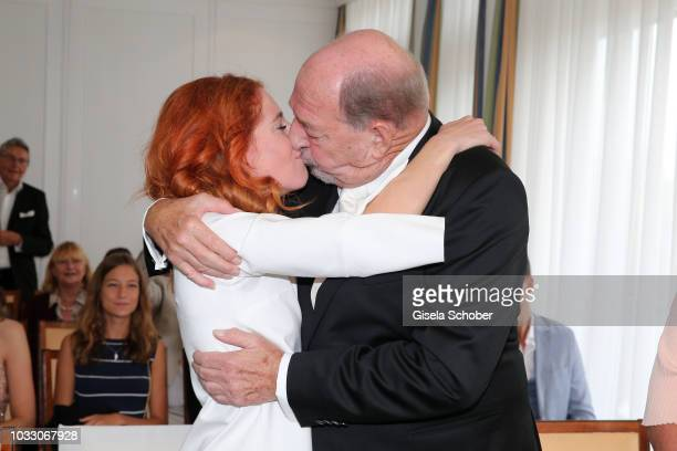 Bride Laura Kaefer and bridegroom Ralph Siegel kiss during their civil wedding at the registry office Gruenwald on September 14 2018 in Munich Germany