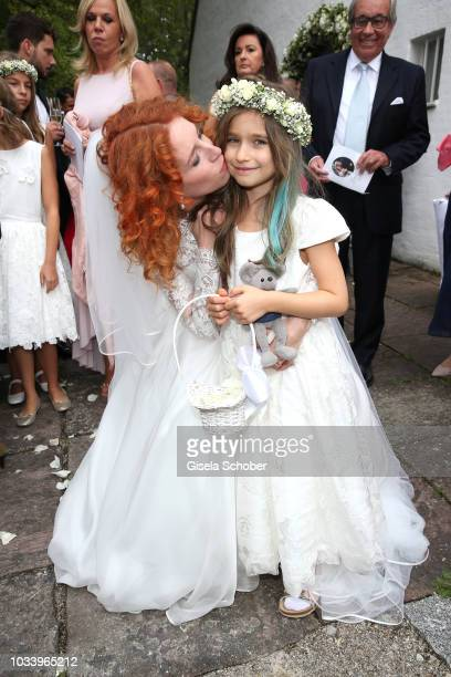 Bride Laura Kaefer and her daughter Ruby Vivian Kaefer during the church wedding of Ralph Siegel and Laura Kaefer at the protestant church...