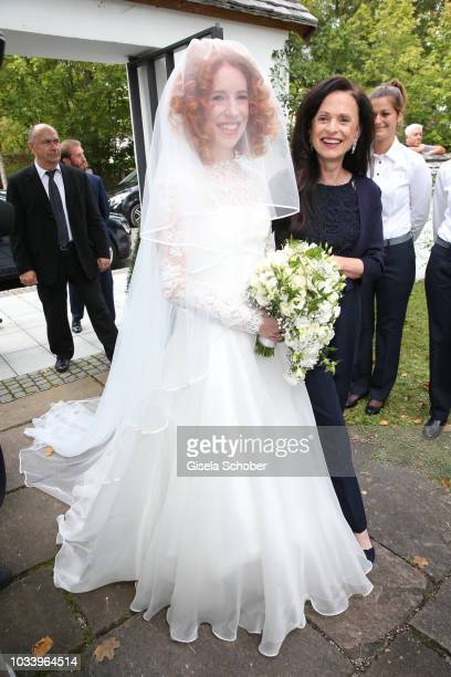 Bride Laura Kaefer and her mother Sylvia during the church wedding of Ralph Siegel and Laura Kaefer at the protestant church Thomaskirche Gruenwald...