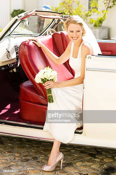Bride Looking Away While Disembarking From Car
