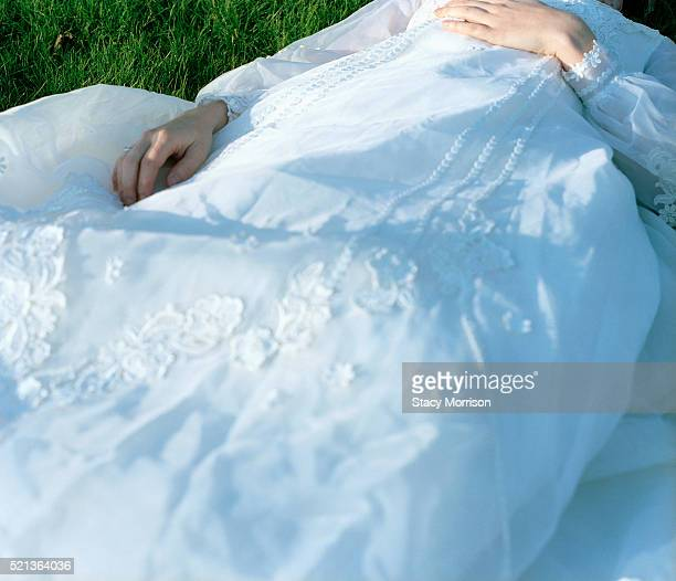 bride lying on grass - fainting stock pictures, royalty-free photos & images