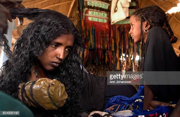Bride Mina has her hair braided in preparation of her wedding in the village of Kanak in Niger Her hands are wrapped with henna to color them for the...