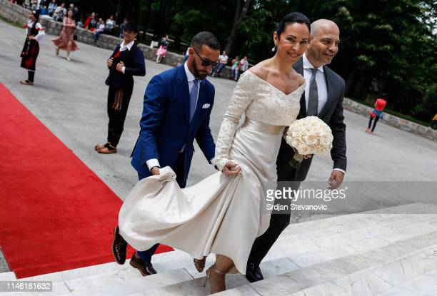 Bride of Prince Dushan, Valerie De Muzio arrives at the wedding ceremony at Oplenac church on May 25, 2019 in Topola, Serbia. Prince Dushan...