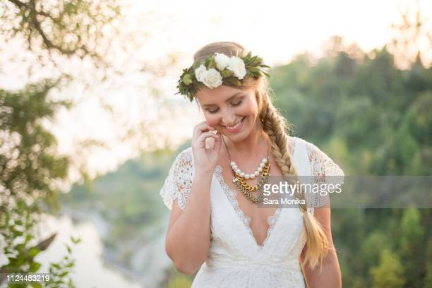 bride on clifftop by coast, scarborough bluffs, toronto, canada - neckline stock pictures, royalty-free photos & images