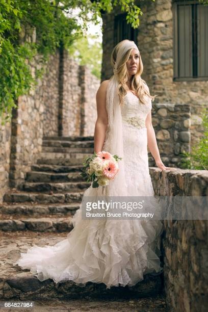bride on stone steps - utah wedding stock pictures, royalty-free photos & images