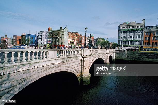 bride over a river, o'connell street bridge, river liffey, dublin, republic of ireland - dublin republic of ireland stock pictures, royalty-free photos & images