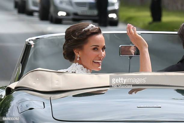 Bride Pippa Middleton and her new husband James Matthews leave St Mark's Church in a classic car after their Wedding Ceremony on May 20 2017 in...