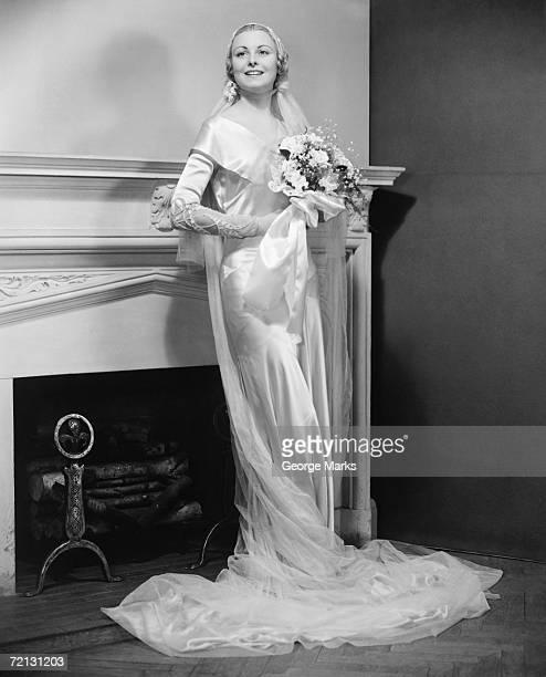 Bride posing at fireplace (B&W), portrait