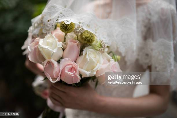 Bride posing with a bouquet