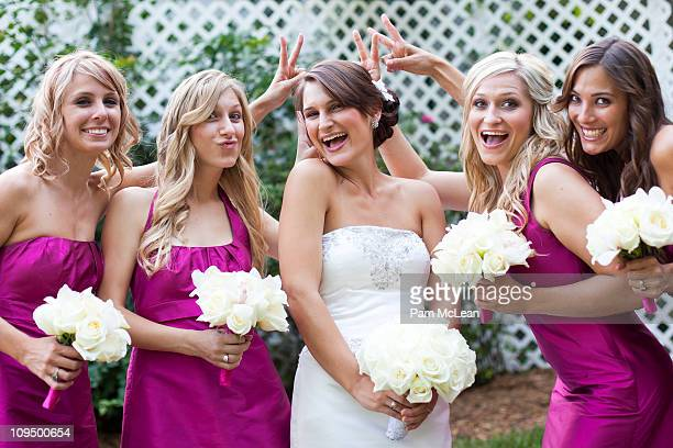 Bride posing with her bridesmaids.